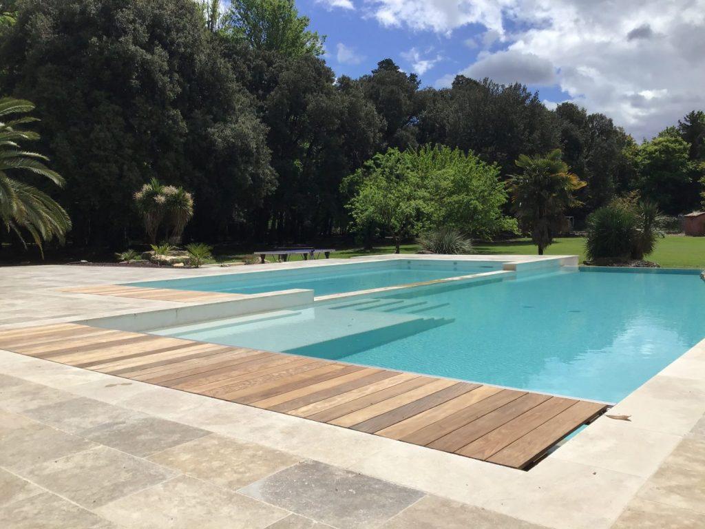 belle piscine double bassin en beton